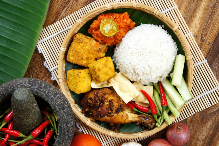 A plates of Delicious 'Ayam Penyet' with 'Sambal Belacan' and 'Tempe'- local flavor, indonesia.jpg