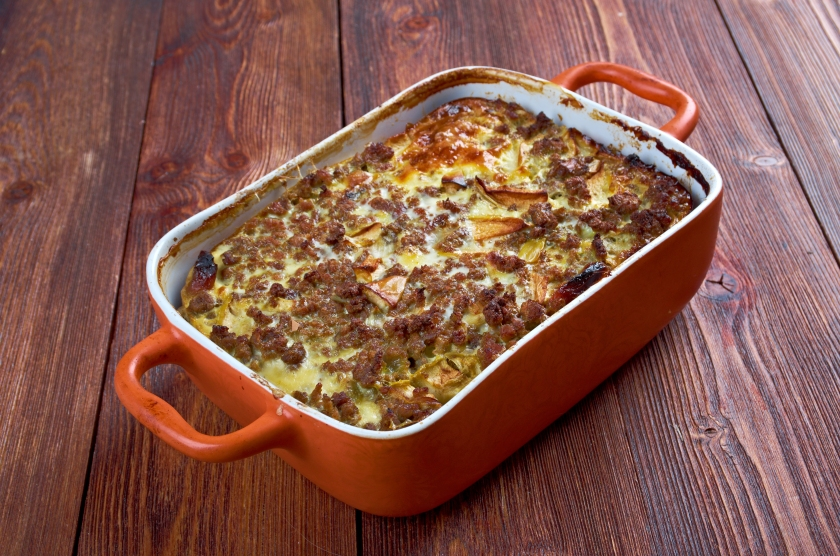bobotjie, is a South African dish consisting of spiced minced meat baked with an egg-based topping,.jpg